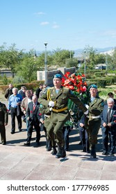 ULAN-UDE, RUSSIA - SEPTEMBER 11, 2009: Russian veterans of the Afghanistan war (1979-89) lay wreaths and flowers to the monument to soldiers died in the war on the 20th anniversary of its ending.