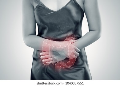 Ulcerative Colitis, The photo of large intestine is on the woman's body against gray background, Female anatomy, Concept with healthcare and medicine