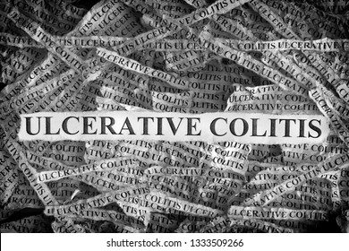 Ulcerative Colitis. Torn pieces of paper with the words Ulcerative Colitis. Concept image. Black and White. Close up.