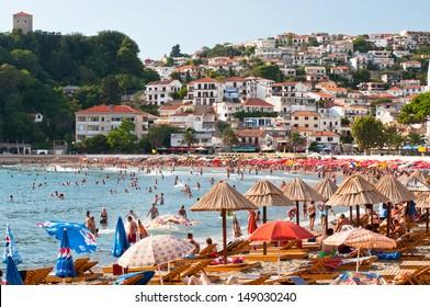 ULCINJ, MONTENEGRO - 5 SEPTEMBER 2012. Town beach with tourists on September 05, 2012 in Ulcinj, Montenegro.