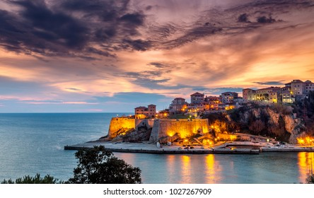 Ulcinj old town fortress with purple after sunset light. Adriatic sea at night in Montenegro.
