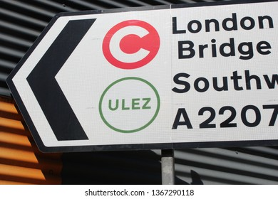 ULEZ, London, UK - April 8 2019: ULEZ (Ultra low emission zone) charge congestion charge & Ultra Low Emission Zone (ULEZ) warning sign central London £12.50  - stock photo photograph image picture