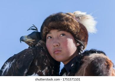 Ulgii, Mongolia - October 2018: Kazakh berkut hunting western Mongolia Golden eagle festival horse riding
