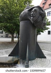 Ulm, Germany - July 20, 2019: Einstein fountain, Memory of bronze sculpture, on the grounds of the historical arsenal, was made by Jürgen Goertz from Sinsheim in 1984. Einstein was born 1879 in Ulm.