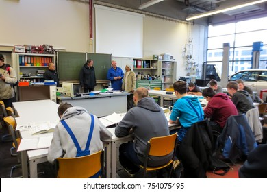 ULM,GERMANY- NOVEMBER 27,2013: Unidentified group of students listening to a lecture in a classroom near Robert Bosch Vocational School, Ulm.
