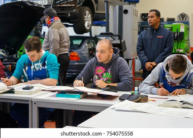 ULM,GERMANY- NOVEMBER 27,2013: Unidentified group of students doing their work in a classroom workshop near Robert Bosch Vocational School, Ulm.
