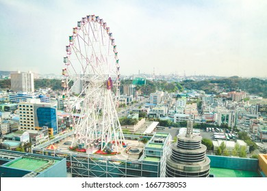 Ulsan,South Korea-April 2018: View of ferris wheel on top of Lotte Department Building from a window.