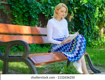 Ultimate best book list. Woman blonde take break relaxing in park reading book. Girl sit bench relaxing with book, green nature background. Reading literature as hobby. Girl keen on book keep reading.