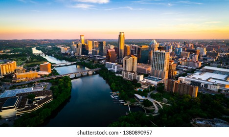 Ultimate sunrise above Lady Bird Lake reflections high above the capital city downtown skyline cityscape aerial drone view of Austin , Texas , USA