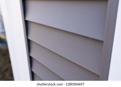 ultra close up vinyl siding texture on new home