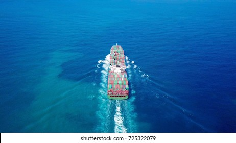 Ultra large container vessel (ULCV) sailing at full speed - Aerial image