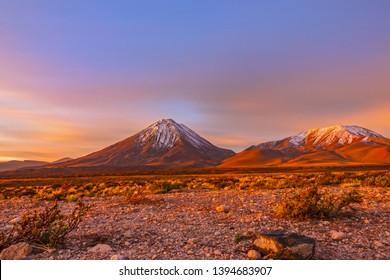 Ultra long exposure merged time-lapse of sunset at Licancabur 6000m volcano in Atacama