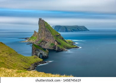Ultra long exposure top amazing view of Drangarnir gate, Tindholmur and Mykines island, Faroe Islands, Denmark.