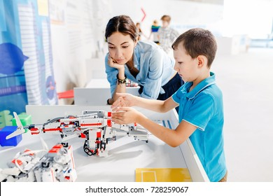 ULTRA MALL, UFA, RUSSIA, 21 AUGUST, 2017: Mom and son are studying robotics and modern electronics at an educational exhibition