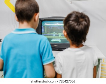 ULTRA MALL, UFA, RUSSIA, 21 AUGUST, 2017: Two boys enthusiastically playing a retro video game on the gaming console