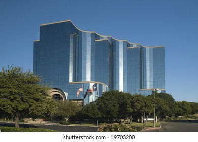 Ultra modern steel and glass office building with angles and curves.