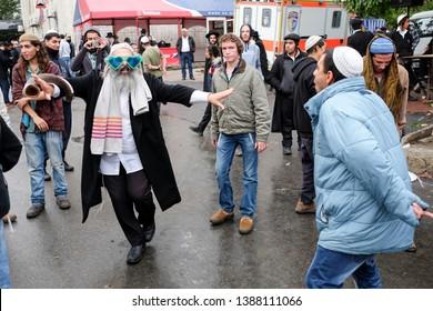 Ultra Orthodox Jewish Hasids  pilgrims dance on the street in Uman. Jewish pilgrims arrive every year on Rosh Hashanah to pray at the grave of Rabbi Nachman of Breslov. Uman, Ukraine. September 2014