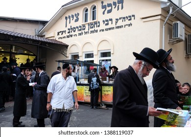 Ultra orthodox Jewish Hasids  pilgrims on the street near the tomb of Rabbi Nachman of Breslov on the eve of Rosh Hashanah holiday, the Jewish New Year, in the town of Uman, Ukraine. September 2014
