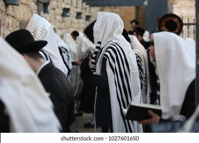 Ultra orthodox Jewish men covered in Tallit pray by the tomb of Rabbi Shimon Bar Yochai in Meron