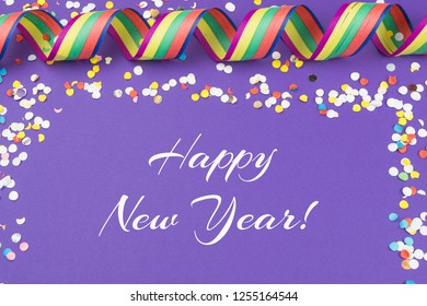 Ultra violet background with confetti, streamers and the best wishes for a Happy New Year