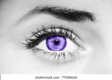Ultra Violet eye on monochrome skin. Concept of demonstrating color of the year 2018. Macro.