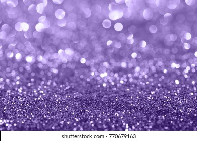 Ultra Violet glitter bokeh background. Festive and sparkles.