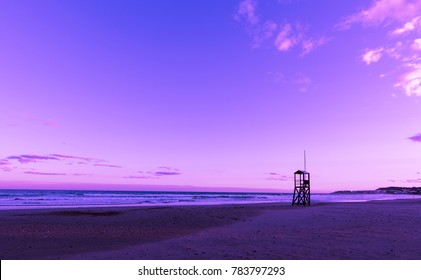 Ultra violet nediterranean beach sunrise with lonely lifeguard wooden tower, Ultra Violet style