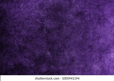 Ultra violet or purple suede texture backdrop. Leather skin natural pattern or abstract background.