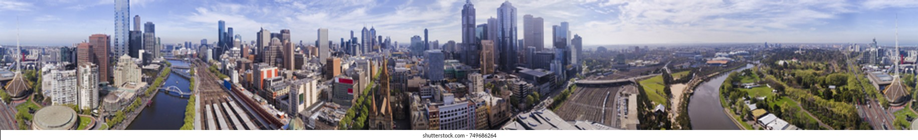 ultra wide 360 degrees panorama of Melbourne city CBD above Yarra river and surrounding high-rises and major city landmarks.