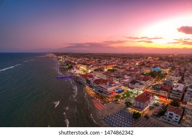 Ultra wide aerial panorama view over the coastal town of Paralia Katerini, Greece at sunset. Located about 8 Km from the city of Katerini in Pieria, central Macedonia, Greece, Europe.
