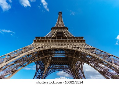 Ultra wide angle of Eiffel Tower over blue sky in Paris, France. Bottom-up view