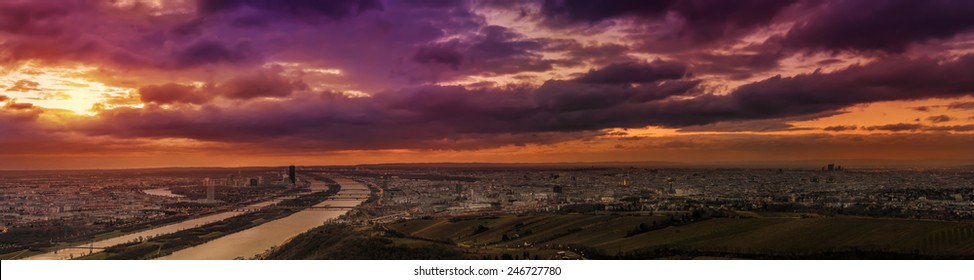 Ultra wide panoramic view of Vienna looking southeast from Leopoldsberg at sunrise
