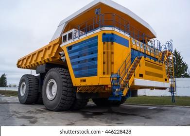 Ultra-Class Haul Truck Copy Space Background. Yellow coloring huge mining haul truck Zodzina, Belarus - March 9, 2016: Haul truck BelAZ 75710 by Belarusian manufacturer BelAZ.
