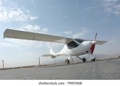 Ultralight aircraft on the runway.