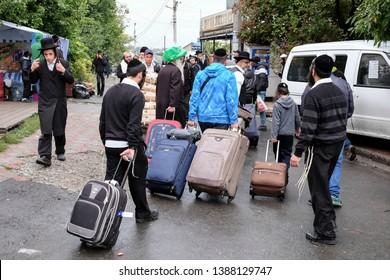 Ultra-Orthodox Jewish Hasids  pilgrims arrive in Uman to pray near the tomb of Rabbi Nachman of Breslov on the eve of Rosh Hashanah holiday, the Jewish New Year. Uman, Ukraine. September 2014