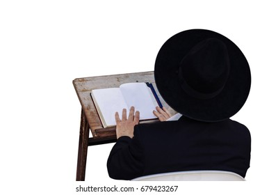 An ultra-orthodox Jewish man reads a book - isolated