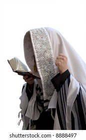 Ultra-orthodox in tallite, that is prayed against the white background in Jerusalem.