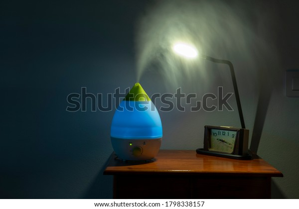 Ultrasonic humidifier with blue light, running at night in the bedroom