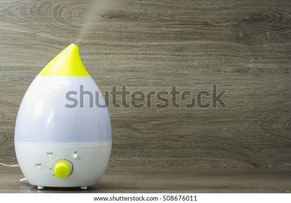 ultrasonic humidifier on the grey wooden background