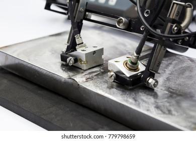 ultrasonic probe testing welding steel ; close up