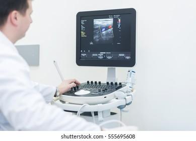 "Ultrasound machine doctor""s hand usg investigation  USCG"