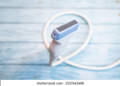 Ultrasound probe floating in air on wooden background