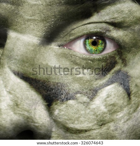 Ultrasound scan of a baby in utero at 12 weeks superimposed on a man's face  as