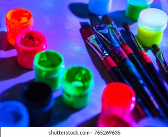 Ultraviolet dyes and brushes in blacklight. Working process. Bright UV painting