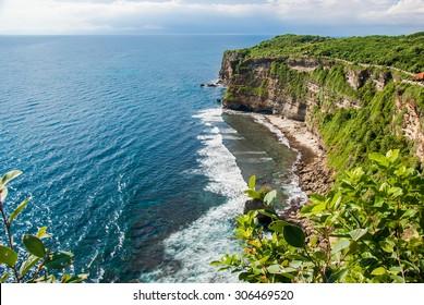 Ulu Watu coastline with beautiful rocky cliffs and wavey sea.