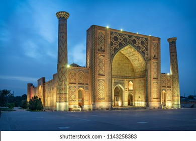 Ulugh Beg Madrasah located on famous Registan square at dusk in Samarkand, Uzbekistan