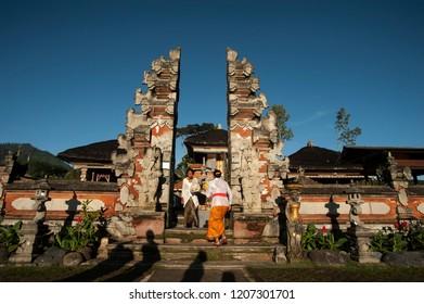 "ULUN  DANU BEDUGUL, BALI,- 7 MARCH  2016: Melasti Ritual is performed before Nyepi - a Balinese ""Day of Silence"" that is commemorated every year on March 7, 2016 in Ulun Danu Bedugul, Bali, Indonesia."