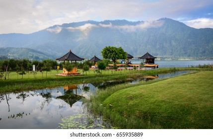 Ulun Danu Park with the lake in Bali, Indonesia. Bali is a popular tourist destination, which has seen a significant rise in tourists since the 1980s.