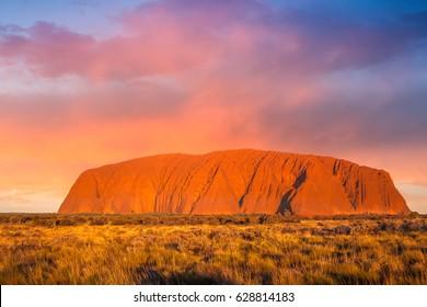 ULURU, AUSTRALIA - CIRCA AUGUST 2016: Uluru at sunset under colorful clouds,Uluru-Kata Tjuta National Park, Northern Territory, Australia