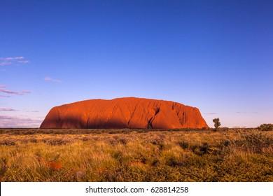 ULURU, AUSTRALIA - CIRCA AUGUST 2016: Uluru at sunset on a clear winter day, Uluru-Kata Tjuta National Park, Northern Territory, Australia